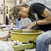 Student working in clay